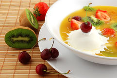 Soup from fruit and berries. Close up on a straw napkin royalty free stock photography