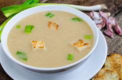 Soup garlic with toasted croutons. On wood table Stock Photography