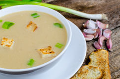 Soup garlic with toasted croutons. On wood table Stock Images