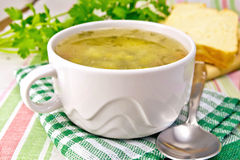 Soup of green peas with bread on tablecloth Royalty Free Stock Images