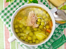 Soup of green peas with meat on tablecloth Royalty Free Stock Image