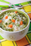 Soup with green peas, rice and carrots royalty free stock photos
