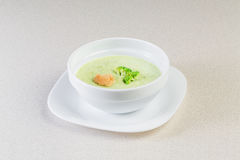 Soup with greens. In a white plate Royalty Free Stock Photo