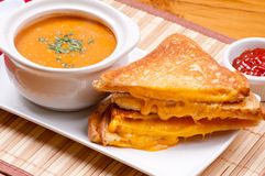 Soup and grilled cheese. Grilled cheese sandwiches and tomato chickpea soup Royalty Free Stock Photos