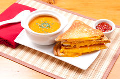 Soup and grilled cheese. Grilled cheese sandwiches and tomato chickpea soup Stock Photography