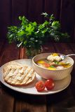 Soup khash in the plate, bread, and a bunch of parsley. Natural food royalty free stock image