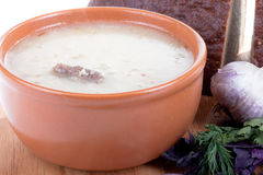 Soup kulesh of millet grains and meat with bread, garlic and her Stock Images