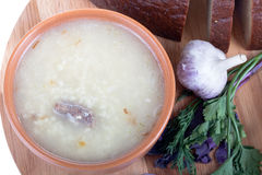 Soup kulesh of millet grains and meat with bread, garlic and her Stock Photo