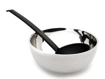 Soup ladle in the bowl Royalty Free Stock Image