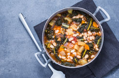 Soup with legumes and vegetables. Soup with different vegetables, beans, kale, top view copy space.Typical tuscan soup ribollita Royalty Free Stock Image