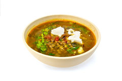 Soup lentil with spinach and cheese in yellow bowl Royalty Free Stock Image