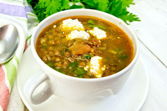 Soup lentil with spinach and feta on light board Stock Images