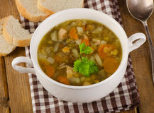 Soup with Lentils, Beans, Chicken and Vegetables on a rustic woo Stock Images