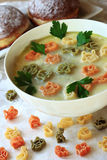 Soup and macaroni in the form of animals Royalty Free Stock Photography