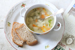 Soup with macaroni and vegetables submitted to a soup tureen Stock Image