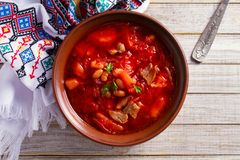 Soup made with vegetables, meat, bean and beet root: borsht, bortsch, borshch, borscht. Traditional dish in Ukraine, Russia, Poland. View from above, top royalty free stock images