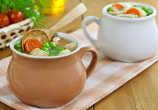 Soup with meat and green peas Stock Image