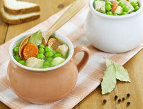 Soup with meat and green peas Stock Photos