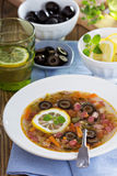 Soup with meat, sausage and olives. Russian soup with meat, sausage and olives Solyanka Royalty Free Stock Images