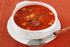 Soup with meat and sausages Stock Images