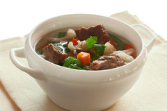 Soup with meat and vegetables. Over white Royalty Free Stock Images