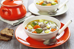 Soup with meatballs and brussels sprouts Stock Image