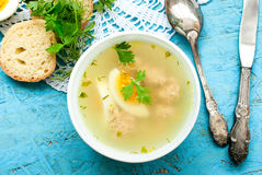 Soup with meatballs and egg Stock Image