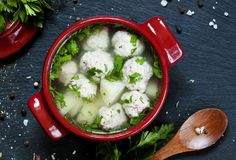 Soup with meatballs in red pots, selective focus. Food still life Royalty Free Stock Images