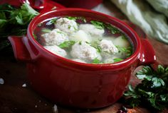 Soup with meatballs in red pots, selective focus. Word `sugar` of white granulated sugar and powdered sugar on dark stone background, top view Stock Image