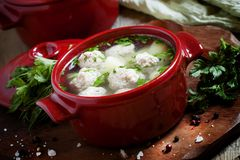 Soup with meatballs in red pots, selective focus. Word `sugar` of white granulated sugar and powdered sugar on dark stone background, top view Stock Photos