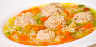 Soup with meatballs, rice and vegetables Stock Photo