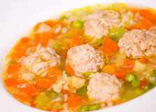 Soup with meatballs, rice and vegetables Stock Image