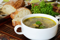 Soup with meatballs. Served with bread on a bamboo tray Royalty Free Stock Photography