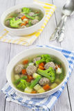 Soup with meatballs and vegetables Stock Image
