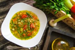 Soup minestrone in a white ceramic plate. Italian Cuisine royalty free stock photo
