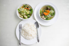 Soup with and mixed vegetable stire-fried served with white rice. Stir the vegetables and serve with steamed rice Royalty Free Stock Image