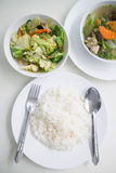 Soup with and mixed vegetable stire-fried served with white rice. Stir the vegetables and serve with steamed rice Stock Images