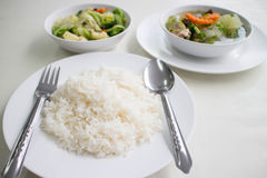 Soup with and mixed vegetable stire-fried served with white rice. Stir the vegetables and serve with steamed rice Royalty Free Stock Photo