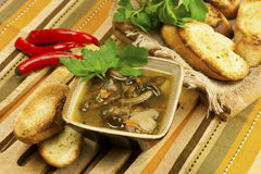 Soup with mushroom and bread Stock Image