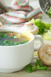 Soup with mushrooms and cheese Stock Image