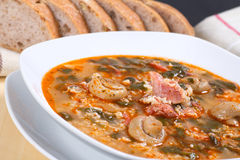 Soup from mushrooms, meat, rice and spinach. Horizontal shot Royalty Free Stock Image