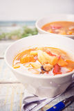 Soup with mussels. Fresh soup with mussels,parsley and pepper Royalty Free Stock Photography