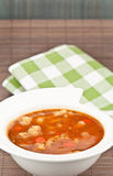 Soup and napkin Stock Image