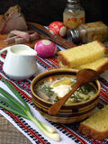 Soup with nettle, sorrel and egg. Soup of sorrel and nettles on the table royalty free stock image