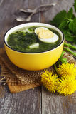 Soup of nettles with eggs Stock Photo