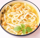 Soup of noodles and chick peas. A fresh asian soup of noodles and chick peas Royalty Free Stock Photo
