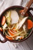 Soup with noodles and chicken close-up. vertical top view Royalty Free Stock Photo