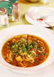 Soup with noodles and mushrooms in a plate Stock Image