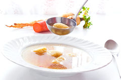 Warm appetizer. Soup with noodles served in a plate,photography Stock Image