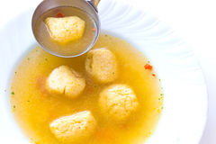 Domestic soup. Soup with noodles served in a plate,photography Royalty Free Stock Photography